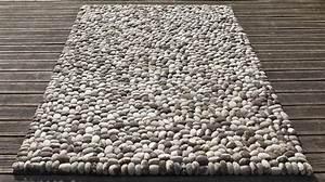 tapis en boules de laine grises effet gallets tapis haut With tapis de salon en laine