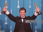 Mel Gibson holds his dual Oscars at the 1996 Academy ...