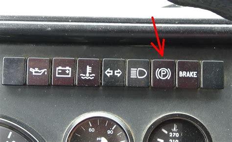 dashboard parking brake warning light stays  air