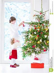 Kids Decorating Christmas Tree Stock Photo - Image: 43685715