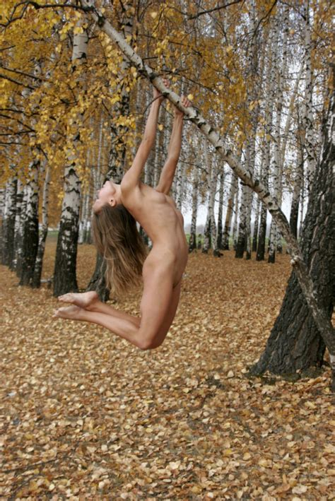 Skinny Russian girl doing gymnastic exercises outdoors ...