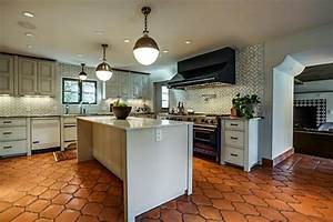 saltillo tile, light gray cabinets, wood baseboards