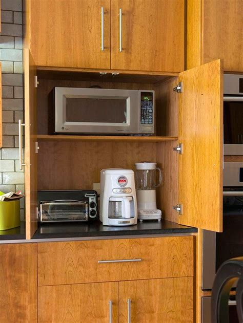 appliance cabinet kitchen an organized breakfast cabinet station 1320