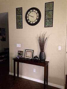 Narrow entryway table wall clock with decorations