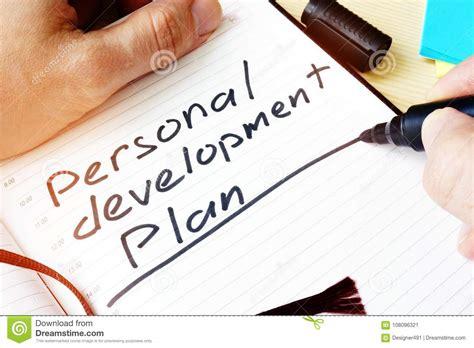 man writing personal development plan stock image image