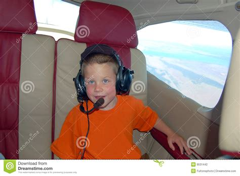 young boy   private airplane stock photography