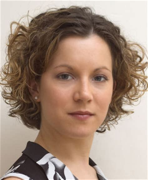 Professional style for naturally short curly hair.