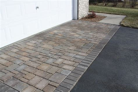 prairie home designs sunken driveway repaired with pavers