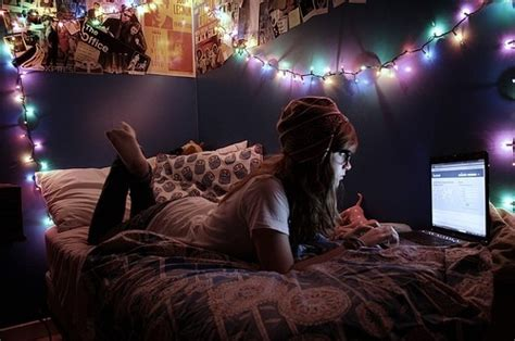 young woman bedroom and string lights bed bedroom facebook laptop lights image