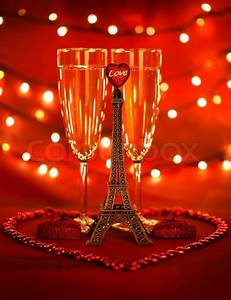 Image of two glass with romantic beverage, little eiffel