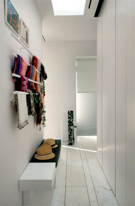 White bench and coat rack in the hallway close   Interior