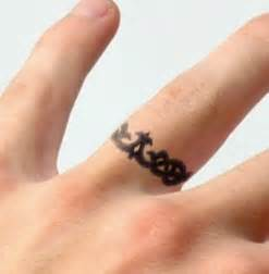 wedding ring finger tattoos 43 awesome wedding ring tattoos weddingomania