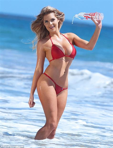 Playboy Model Sarah Harris In A Bikini Dousing Herself From A Bottle On The Beach Daily Mail