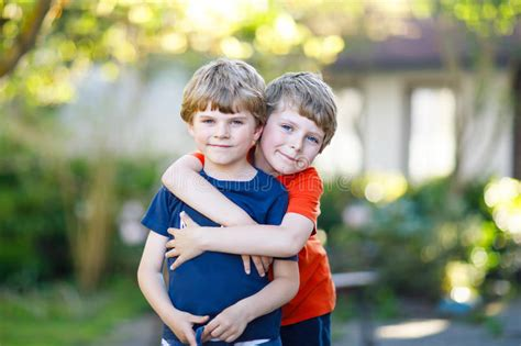 two active school boys and siblings 479 | two little active school kids boys twins siblings hugging summer day cute brothers preschool children best friends 94308599