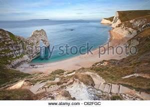 Durdle Door along the Jurassic Coast at sunrise. Dorset ...