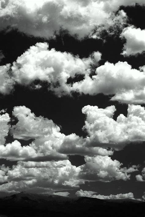 high clouds mountain horizon fluffy white black and by