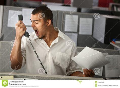 employe de bureau employé de bureau fâché photos libres de droits image