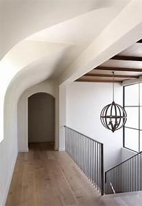 Mediterranean Home Features An Iron Staircase Railing