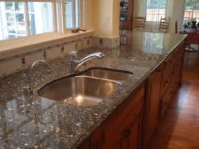 kitchen islands with butcher block tops how to clean granite countertops care of granite