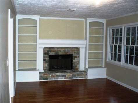 wall around fireplace originally a full brick wall with the tiny fireplace in the middle now with built in