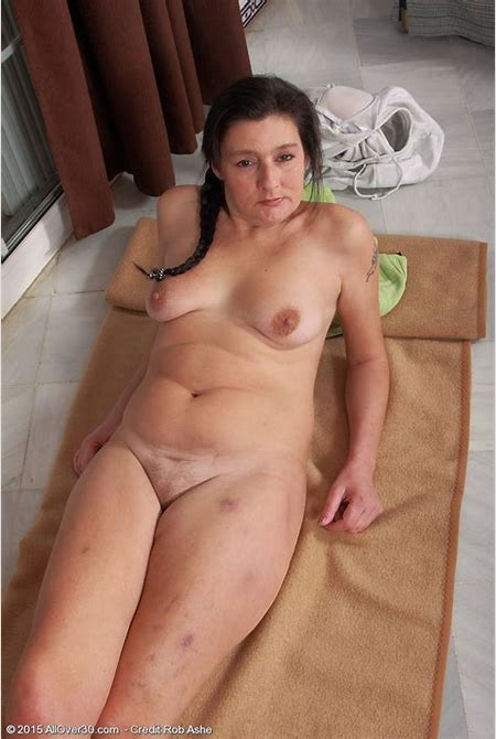 She enjoys every second of that undressing and making her pussy very wet before taking MILF photos.