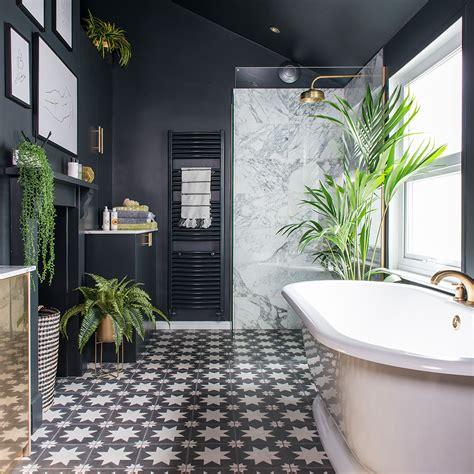 black bathroom makeover  patterned floor tiles plants