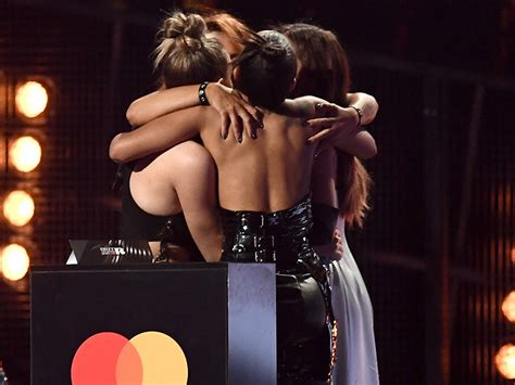Portrait of happy sisters hugging and laughing. Love Letter to Girl Group Little Mix