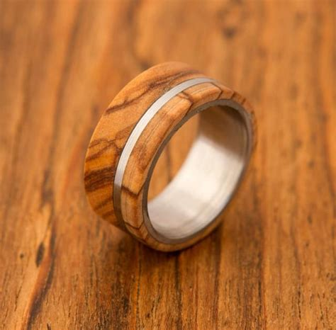 Olive Wood Ring Titanium Ring Band Mens Ring #2435077. Wood Pendant Necklace. Set Diamond. Brown Leather Necklace. Key Lockets. Arrow Stud Earrings. Bumble Bee Pendant. College Student Watches. Ethical Diamond Engagement Rings