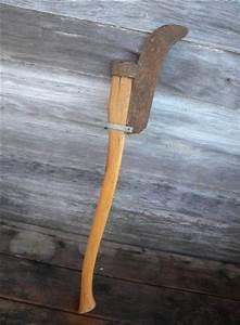 antique vintage billhook or brush axe, primitive old farm tool