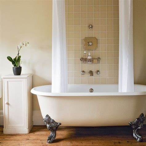 roll top bath bath shower and tiling on