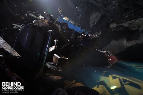 underground car graveyard cavern of the lost souls