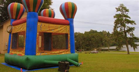 bounce house blows away bounce house blows away with three children inside and