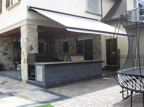 retractable awning  outdoor kitchen contemporary patio toronto  rolltec awnings