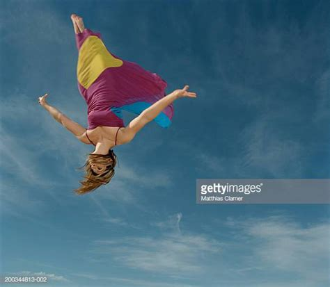 Upside Down Woman In Dress Falling Photos and Premium High ...