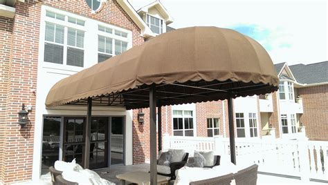 Post Supported Awning Over Patio Area