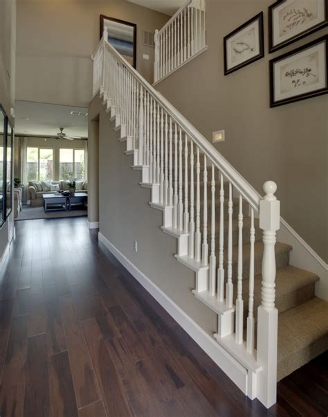 wooden banister designs the white banister wood floors and the wall color