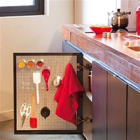 pegboard inside the kitchen cabinet doors organization