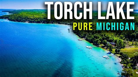 Also torch lake does not have the house boats that were lake michigan is the lake that divides wisconsin and michigan. Torch Lake & Higgins Lake | Pure Michigan Camping - YouTube