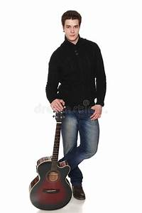 Man In Full Length Standing With Acoustic Guitar Stock ...