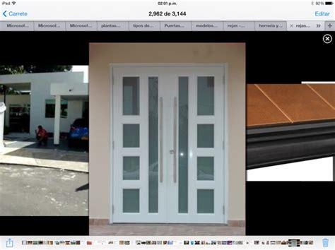 foto puerta acceso principal de tecno aluminio  cristal