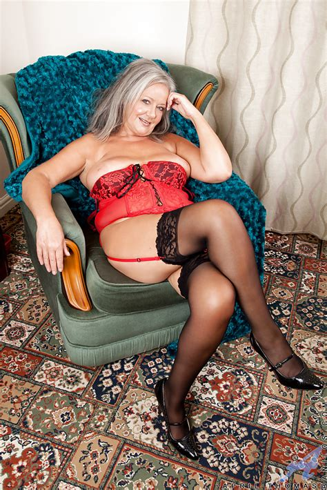 chubby granny in stockings reveals her sexy lingerie and