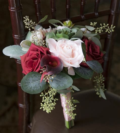 natural touch christmas red rose  pine cones bouquet