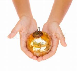 Hands holding christmas ball Stock Photo Colourbox