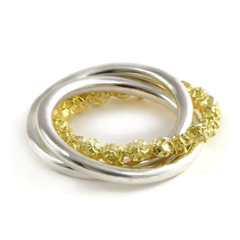 18ct yellow gold and silver russian wedding ring design