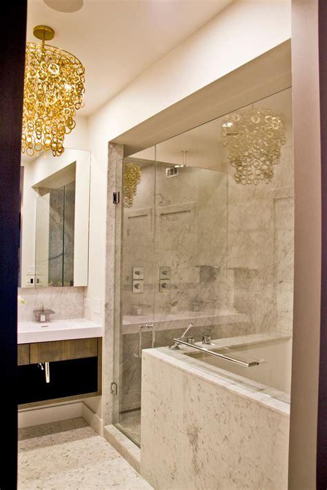 modern white bathroom  glass enclosed marble shower hgtv