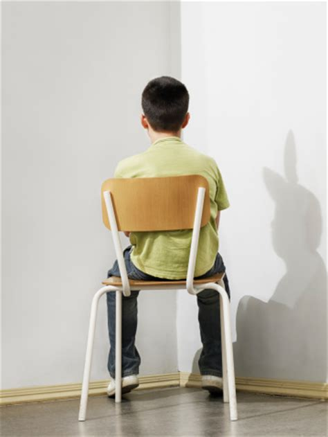 boy sitting on chair rear view stock photo getty images