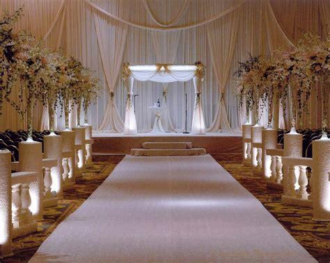 elegant white hotel ceremony decor wedding ceremony