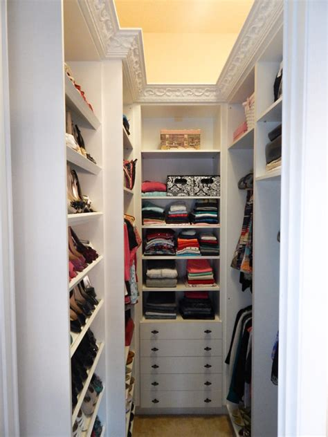 interior ultra small narrow white walk in closet design