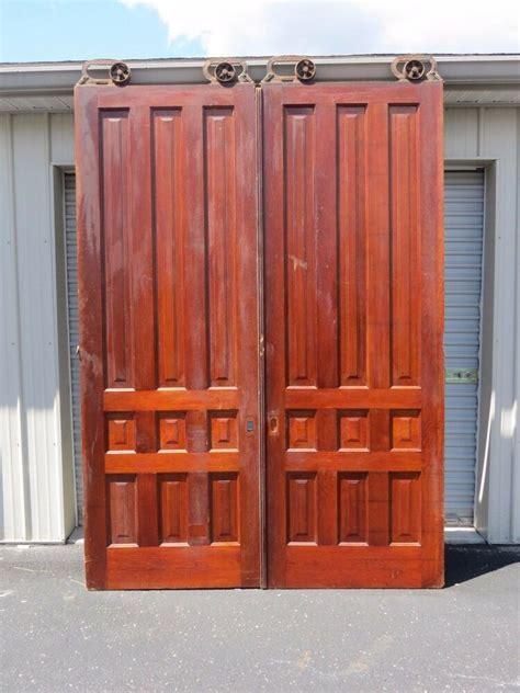 antique pair  ft tall cherry interior sliding pocket