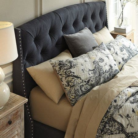 deeply tufted headboard dotted with shimmering nailhead